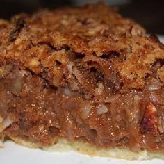 German Chocolate Pie So Good! This recipe came from an Amish woman who sold baked goods at our local Farmer's Market. She was so generous to give out her great recipes. She made the pie crust from scratch, of course. But you can buy refrigerated crust o Köstliche Desserts, Delicious Desserts, Dessert Recipes, Yummy Food, Plated Desserts, German Chocolate Pies, Chocolate Pie Recipes, Chocolate Chips, Chocolate Cake