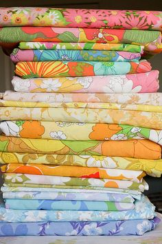 stack of vintage sheets printed in cheerful colors | All About Vintage Sheets! - InColorOrder.com