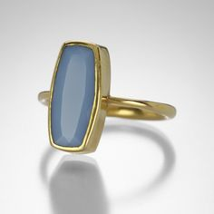 Sweet and subtle, this opal Annette Ferdiandsen ring can enhance any stacked collection. The rectangular gem is housed in an 18k yellow gold minimal bezel, on a rounded band. Pile them on!Stone measures 15.6mm x 17.5mm.Size 6.RING SIZING OPTIONS