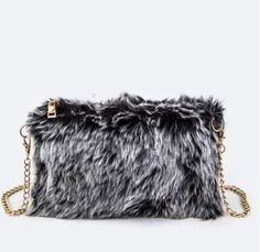 "The hottest celeb designers are going crazy over fur bags this season. This fur baby comes in cream, brown or black.  The perfect cross body for the winter!      	Length - 10""  	Width - 1""  	Height - 6.5""  	Composition - Faux Fur   