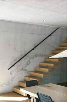 Raw concrete and wooden stairs, I actually like the look Marble Stairs, Tile Stairs, Concrete Stairs, Floating Stairs, Concrete Wood, Wood Stone, Painted Stairs, Wooden Stairs, Black Stair Railing