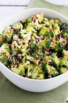Sweet and Sour Broccoli Salad (with onion, pecans, bacon and cheese. Dressing: mayo, vinegar, sweetener and spices.)