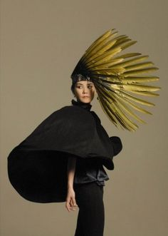 outtakes from faye wong's shoot for her upcoming concert promotional materialsedit: she wears a headpiece made of eagle feathers by erik halley. Faye Wong, Madd Hatter, Feather Hat, Crazy Hats, Fancy Hats, Body Adornment, Love Hat, Fabric Manipulation, Hat Making