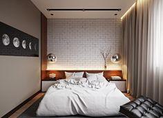 chambre adulte avec un grand lit tout confort et suspensions en forme de boule