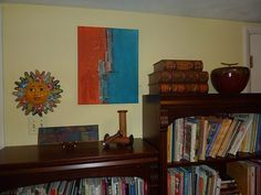 Letterlady's Letters - Display art in your home or office.  This one was originally intended to be horizontal, but turned on its side, it's perfect for the spot!  The color even ties everything together - the large books to its right have the colors, and the happy Mexican sunshine does too.