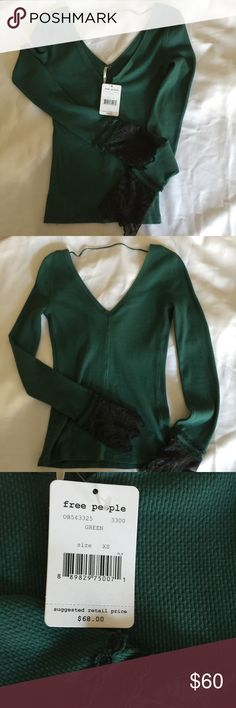 Free People Thermal with lace sleeves NWT!! Stunning Free People Thermal. Brand New!! Gorgeous green color with lace on the sleeves. Deep v neck on front and back. No rips, stains etc. Free People Tops Tees - Long Sleeve