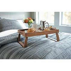 Take breakfast-in-bed up a notch with the charming Threshold Acacia Bed Tray. This stylish serving tray features metal side handles and folding legs for easy carrying and space-saving storage. It is crafted from durable, gorgeous acacia wood that offers an artisan look at a valuable price. Wipe clean with damp cloth.