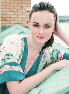 Alexis Bledel can represent Clear Summer with her stunning clear blue eyes and dark blond/light brown hair. In subdued tones like on the photo seems not the best. They are cool, but softened. She needs clear cool tints near the face, not tones!