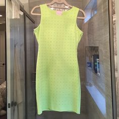 Lime green studded dress Lime Green cut out back mini dress with gold studs. Nice thick fabric so fit is very flattering. Has one small glue dot on the front where maker must've missed the stud which I tried to show a photo of. Also is missing one stud on the very top of the sleeve which you cannot see. The glue dots are not noticeable once you have the dress on. I wore it once and had bronzer on so there's just a little bit of wear that shows on the armholes but still in great shape Romeo…