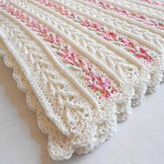 A gorgeous, handmade, keepsake baby afghan would make a perfect baby shower gift or an heirloom to be passed down through the family. It would also be a fantastic photo prop too! Generously sized for crib use, it's ideal for the newborn infant baby, toddler or young child or it could even be used as a throw blanket, a lapghan, a lap robe or for wheelchair use.The design is written in standard U.S. terminology and based on a stitch pattern for a pillow design I made in the 1960s. The Avalon…