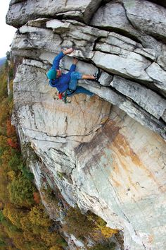 Awesome photo of a guy pulling the roof on Erect Direction (5.10c).