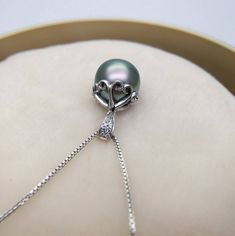 We've taken the classic pendant necklace up a notch. https://www.noblag.com/us/18k-gold-tahitian-pearl-diamond-pendant-10mm.html #tahitianpearls #Tahitiannecklaces #pearljewelry #trendy