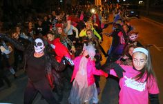 """Gillian Skidmore, Peneolope Wilson and Michelle Geasy lead the dancers of Gillian's Dance Arts in their rendition of Michael Jackson's """"Thriller"""" in tonight;s Halloween Parade in Oneonta."""