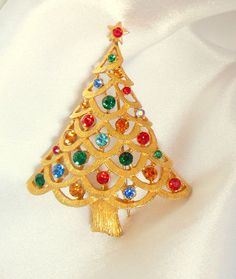 The perfect bit of sparkle. All $18 goes to charity. Christmas Tree Brooch by VJSEJewelsofhope on Etsy, $18.00.