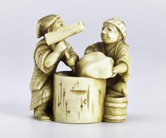 Netsuke of carved ivory, a man and a woman pounding mochi (rice cakes): Japan, by Gyokushu, 19th century