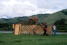 Setting up a ger, Terelj National Park Gers are easy to put up.  The lattice work forms the wall, and supports the long roof poles, which come together at the central ring. The door always points to the south.