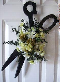 Don't know about those flowers but like the idea for her door at salon!!!
