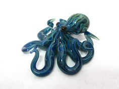 Small Glass Octopus pendant Electric Blue. EmergentGlassworks, $30.00, via Etsy.