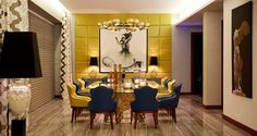 The contrasting colors of blue and yellow give this dining room a royalty touch. At the center, you have the large rectangular Koi Dining Table, complemented by blue and yellow Touareg Dining Chairs. From the ceiling, falls the beautiful Horus Suspension Lamp. By the yellow wall, the ambience is set by two fine and stunning Gem Table Lamp by KOKET. Let's Celebrate design with friends