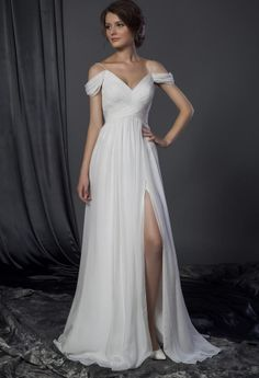 Here is a draping off the shoulder wedding gown with leg slit. Get this bridal dress made in any color for any type of formal function. We have many other off the shoulder wedding dresses at www.dariuscordell.com