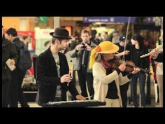 Flashmob Orchestra performs Carmina Burana at a train station in Germany