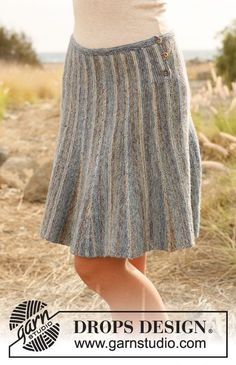 """Rays in the Fog - Knitted DROPS skirt with stripes worked from side to side with short rows in """"Fabel"""". - Free pattern by DROPS Design Skirt Pattern Free, Crochet Skirt Pattern, Crochet Skirts, Knit Skirt, Crochet Clothes, Knit Dress, Free Pattern, Skirt Patterns, Coat Patterns"""