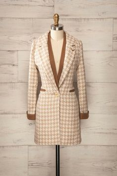 I own this! So, it should be in my current closet in a few weeks. Hertfordshire - beige and light brown houndstooth coat with deer brooch