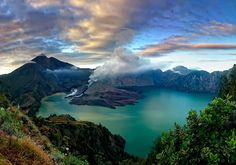 Mount Rinjani or Gunung Rinjani is an active volcano in Indonesia on the island of Lombok. Administratively the mountain is in the Regency of North Lombok, West Nusa Tenggara Places To See, Places To Travel, Travel Destinations, Paradise Island, Lombok Bali, The Tourist, Voyage Bali, Gili Island, To Infinity And Beyond