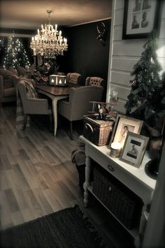 Black dining room | black paint color | dining room | glam dinning room | chandelier | Christmas decor