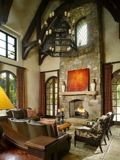I love everything but that awful dungeon style chandelier Hacienda Style, Colorado Homes, Arched Windows, Curtain Ideas, Tuscan Style, Fireplace Mantel, Fireplace Ideas, Home Accents, Great Rooms