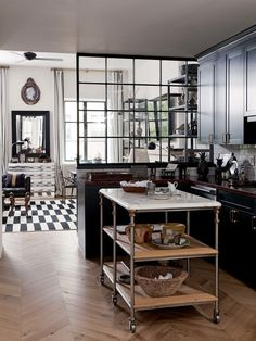 Nate Berkus Associates's Manhattan Townhouse on 1stdibs. Love glass & metal window partition between kitchen & dining area.* Marble topped rolling cart.*