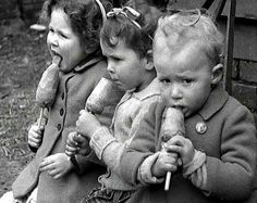children in London eating carrot lollipops 1940