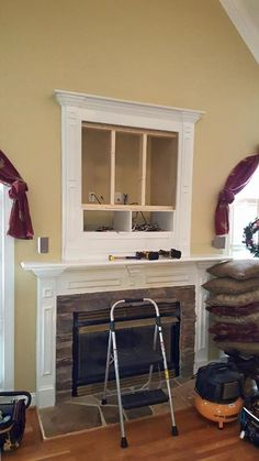Make that outdated hole above fireplace vanish by installing a flat screen TV covering it. Custom TV mounting over fireplace niche, Charlotte, Fort Mill