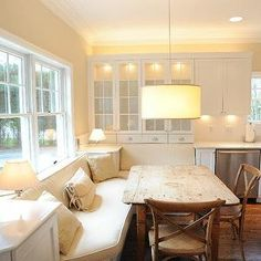 Banquette Beautiful Cottage Chic Kitchen eating area - built in-bench, country table & Chairs. Love the built in bench--makes breakfasts more cozy. Would only work if there was a separate dining room for when guests come.