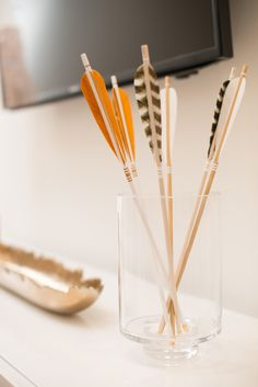 Feather tip arrows in glass jar