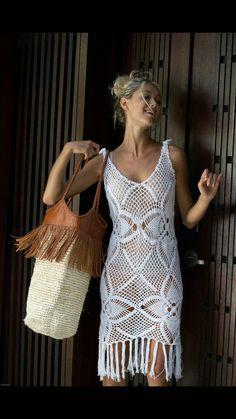 This stunning handmade crochet dress has a detailed pattern and fringe on hem line. It would be beautiful for a beach wedding or just a special dress to enjoy and look elegant in.  Features 100% cotton Handmade crochet Fringe on hem line  One size fits small to Medium  Wholesale Welcome  If you would like to place an order for this , please take into consideration the following timeline details*  Please allow 1-2 weeks production time: M A D E ~ T O ~ O R D E R Estimated delivery for EMS…