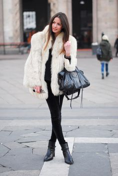 oversized white fur coat with black pant underneath
