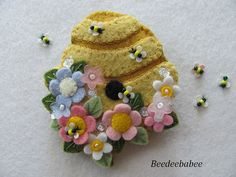 This ooak beehive pin measures 2 1/4 across by 2 1/2 top to bottom. Its made of 100% wool felts in bright, happy colors, and embellished with embroidery, flower beads and my Itty-Bitty Bees!    This is a clean, smoke free home. I ship my things within 3 business days of your payment. Your goodies arrive sweetly gift boxed. Everything is sent with delivery confirmation.    Come visit my blog at Beedeebabee.blogspot.com :)      Happy Etsying!!!  Paulette :o)