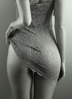 Sometimes less is more. This woman is totally covered yet this is a very erotic photo in my opinion.
