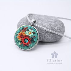 MATERIALS: polymer clay, rhinestones, silver tone metallic pendant base. 30 mm in diameter; weight 9 grams. Polymer clay item is not scratch resistant. I do not recommend to attach your piece to a keychain for this reason. It's better to keep your polymer clay item in a soft textile bag, separated from other accessories. Avoid applying hairspray while wearing your jewelry or accessory. To clean from dust - use very soft brush.
