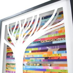 """Tree Shadowbox (by Amy Gibson) (2/2) - intricately hand-cut tree against a multi-hued collage of discarded pages. Shadowbox is 20.5"""" x 20.5"""", frame is .75"""" thick and 1.75"""" deep."""