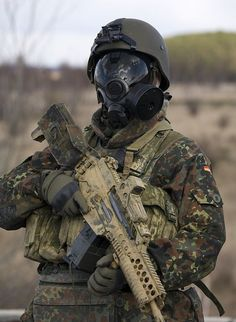 militaryarmament:  Bundeswehr soldier with a shiny ass gas mask.