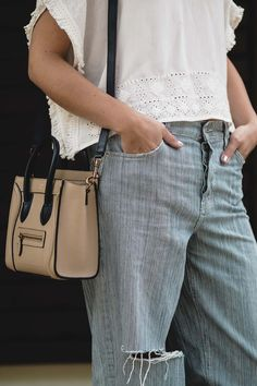 ripped boyfriend jeans, cropped embroidered top, celine nano bag