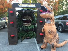 Trunk or Treat - Jurassic Park - stacked cardboard boxes, plants from thrift store, and homemade dino head from cardboard and spray insulation.