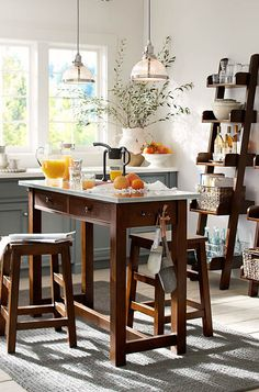 From small to all — kitchen furniture that compliments the room. #potterybarn