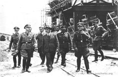 On March 1, 1941 Reichsführer SS (SS Commander) Heinrich Himmler carried out his first inspection of Auschwitz. In the picture you can see Heinrich Himmler surrounded by SS men during his second visit to Auschwitz – in July 1942 – at the site of IG Farben industrial plant. Next to Himmler (left in the first row) you can see senior IG Farber engineer Maximilian Faust (in a hat) and Rudolf Hoess - the commandant of Auschwitz.
