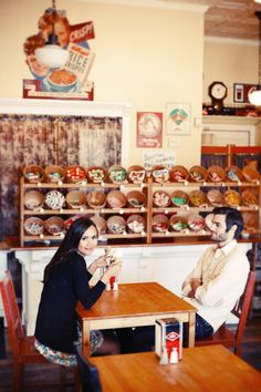 31-engaged-couple-retro-candy-shop-table