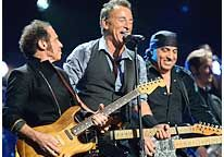Nils Lofgren, Bruce Springsteen & Steven Van Zandt of The E Street Band perform at '12-12-12,' a concert to aid the victims of Hurricane Sandy, on Wednesday (© Kevin Mazur/WireImage for Clear Channel)