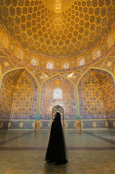 Iranian woman dressed in chador inside Sheikh Lotfollah Mosque...