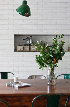 white subway tile, brown wood, green. this kitchen is the love of my life.